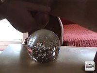 Cumming over a glass paper weight