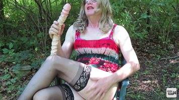 Sucking on a big dildo outdoors yesterday